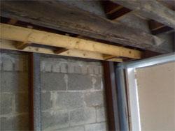 Structural repair needed for this garage door opening.